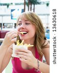 girl enjoying french fries | Shutterstock . vector #13630618