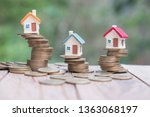 mini house on stack of coins ... | Shutterstock . vector #1363068197
