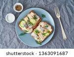 Stock photo herring smorrebrod traditional danish sandwiches black rye bread with herring on dark gray 1363091687