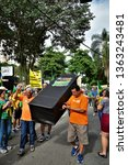 Small photo of Sao Jose dos Campos / Sao Paulo / Brazil - April 7, 2019: Demonstrators carrying a coffin fake of Gilmar Mendes a demonstration of repudiation of the society in the demonstration against the Federal S