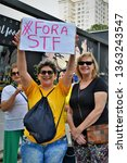 """Small photo of Sao Jose dos Campos / Sao Paulo / Brazil - April 7, 2019: Protest of a woman with the plaque """"Outside STF"""" in repudiation of the Federal Supreme Court"""