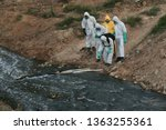 Small photo of 05 APRIL 2019. Hazmat team wearing a Hazmat suit to clean a river after toxic chemical were dumped into the Sungai Kim Kim, sickening thousand of people who inhale noxious fumes in Johor