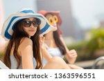 two young women wearing hat... | Shutterstock . vector #1363596551