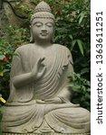 buddha statue in plants | Shutterstock . vector #1363611251