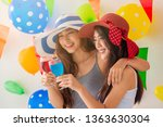 two asian woman drinking... | Shutterstock . vector #1363630304