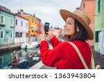 smiling tourist takes photos in ... | Shutterstock . vector #1363943804
