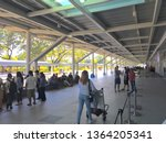 Small photo of Palawan, Philippines; April 4, 2019: Passengers and their companions walk and loiter about in an area outside of the new Puerto Princesa International Airport which became operational in 2017.