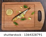 Stock photo baltic herring cold smoked with dill green onions and lime on a wooden cutting board aromatic 1364328791