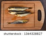 Stock photo several baltic herrings cold smoked on a wooden cutting board several aromatic baltic herrings 1364328827
