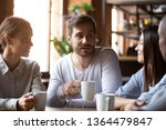 Stock photo multi ethnic group of best friends millennial girls and guys chatting sitting in cafe employees 1364479847