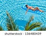 Woman In Red Swimsuit Sunbathe...