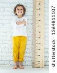 child measures height  | Shutterstock . vector #1364811107