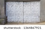 old ornate metal gates to... | Shutterstock . vector #1364867921