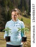 woman gardener watching her... | Shutterstock . vector #1364886557