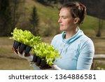 woman gardener watching her... | Shutterstock . vector #1364886581