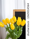 a bouquet of yellow tulips on a ... | Shutterstock . vector #1365014564