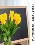 a bouquet of yellow tulips on a ... | Shutterstock . vector #1365014567