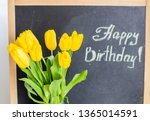 a bouquet of yellow tulips and... | Shutterstock . vector #1365014591