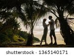young stylish couple a man with ... | Shutterstock . vector #1365140171