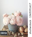 Small photo of easter pink bombastic roses and chalkboard with Easter text on it