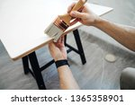 the hands of men with a brush ... | Shutterstock . vector #1365358901