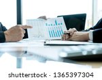 young business team in a small... | Shutterstock . vector #1365397304