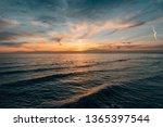 sunset over the pacific ocean ...   Shutterstock . vector #1365397544