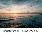 sunset over the pacific ocean ...   Shutterstock . vector #1365397547