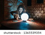 scary witch with human skull... | Shutterstock . vector #1365539354