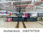 Small photo of Industrial cloth cutting machine and fabric cutting area in garment factory in industrial zone in Ho Chi Minh City, Vietnam, with modern machinery and technology systems.