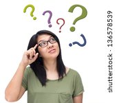 asian woman thinking with lots... | Shutterstock . vector #136578539