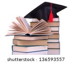 grad hat with books isolated on ... | Shutterstock . vector #136593557