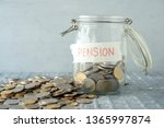 coins in glass money jar with... | Shutterstock . vector #1365997874