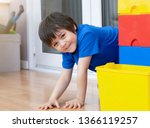 portrait active kid boy hiding... | Shutterstock . vector #1366119257