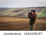 hiking man looking for animals... | Shutterstock . vector #1366198157
