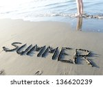 Summer writing on sand vacation - stock photo