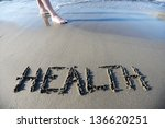 Health writing on sand - stock photo