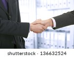 two business men shaking hands | Shutterstock . vector #136632524