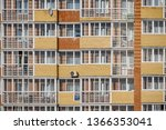 a glass facade with windows of... | Shutterstock . vector #1366353041