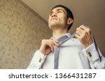 tying knot of a tie. attractive ... | Shutterstock . vector #1366431287
