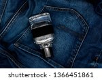 blue jeans and men's perfume | Shutterstock . vector #1366451861