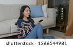 woman watch tv at home | Shutterstock . vector #1366544981