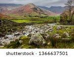 boulder strewn beck running... | Shutterstock . vector #1366637501