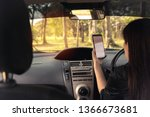 Small photo of Blurred images, women drove their cars astray into the forest because she was driving on the phone's GPS guidance.