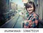 Hipster Girl On Balcony Smiling