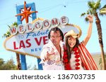 Stock photo las vegas elvis impersonator having fun cheering by welcome to fabulous las vegas sign funny happy 136703735