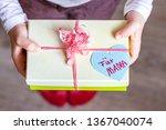 little child holding gift box... | Shutterstock . vector #1367040074