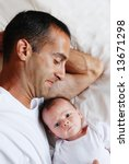 a father lying in bed with his... | Shutterstock . vector #13671298