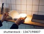 woman holding paper book...   Shutterstock . vector #1367198807