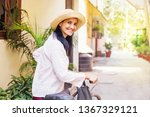 pretty woman in her 40s riding... | Shutterstock . vector #1367329121